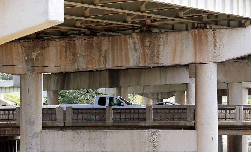 Photo -  Cars on Northwest Expressway pass underneath the Belle Isle bridge Monday in Oklahoma City. Photo by Nate Billings, The Oklahoman   NATE BILLINGS -