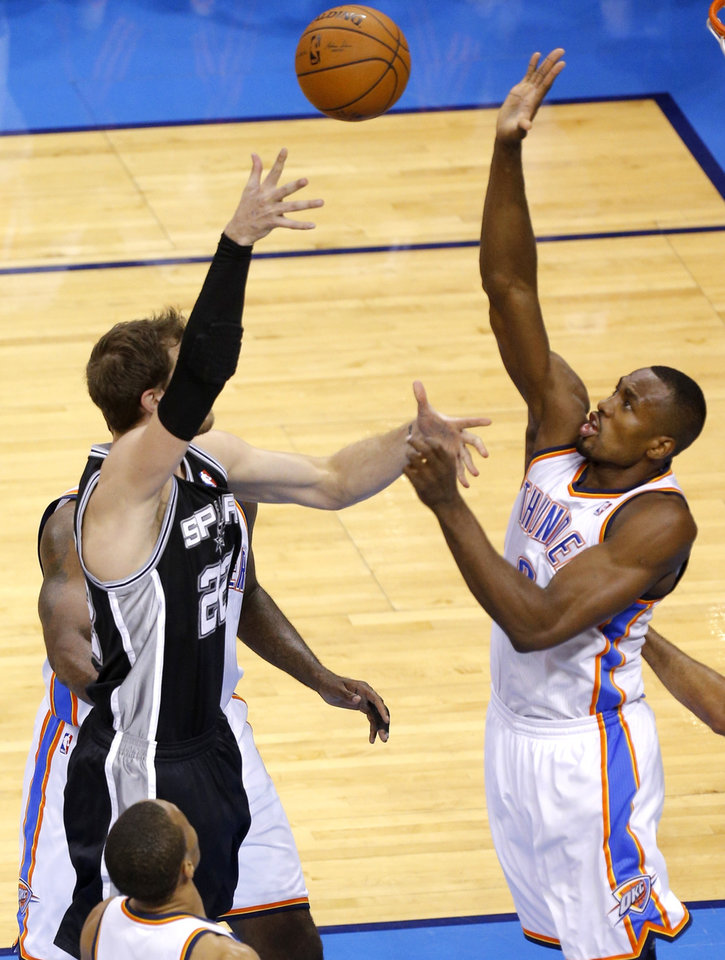 Photo - Oklahoma City's Serge Ibaka blocks the shot of Tiago Splitter during Game 4 of the Western Conference Finals in the NBA playoffs between the Oklahoma City Thunder and the San Antonio Spurs at Chesapeake Energy Arena in Oklahoma City, Tuesday, May 27, 2014. Photo by Bryan Terry, The Oklahoman