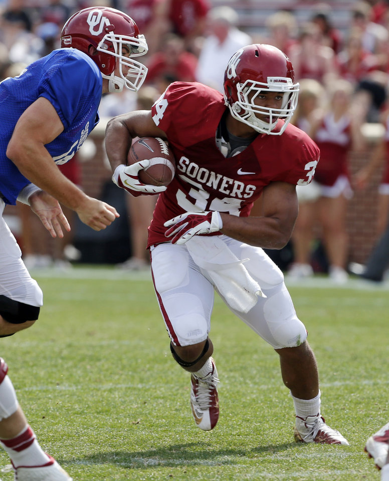 Photo - Daniel  Brooks (34) carries during the Spring College Football Game of the University of Oklahoma Sooners (OU) at Gaylord Family-Oklahoma Memorial Stadium in Norman, Okla., on Saturday, April 12, 2014.  Photo by Steve Sisney, The Oklahoman