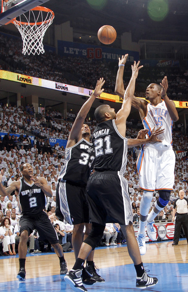 Oklahoma City's Kevin Durant (35) shoots over San Antonio's Boris Diaw (33) and Tim Duncan (21) during Game 6 of the Western Conference Finals between the Oklahoma City Thunder and the San Antonio Spurs in the NBA playoffs at the Chesapeake Energy Arena in Oklahoma City, Wednesday, June 6, 2012. Photo by Chris Landsberger, The Oklahoman
