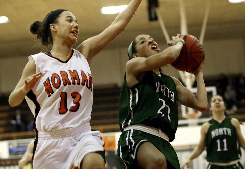 Norman High's Lexi Seburg tries to stop Haley Woodard on a fast break layup as the Norman High School Tigers play the Norman North Timberwolves on Friday, Feb. 15, 2013  in Norman, Okla. Photo by Steve Sisney, The Oklahoman