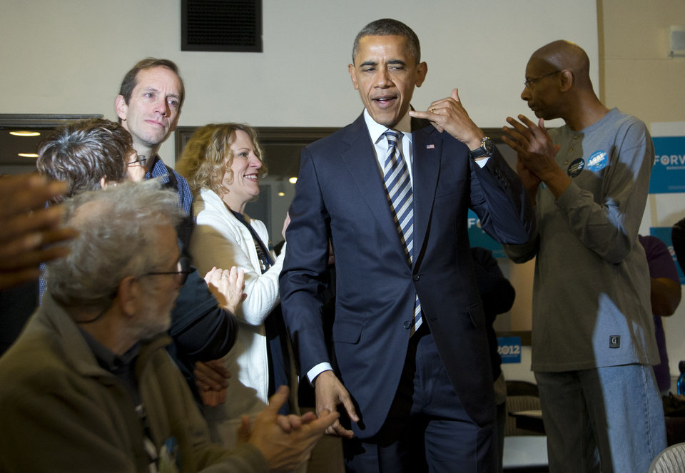 President Barack Obama gestures during a visit with volunteers in a call center at a campaign office the morning of the 2012 election, Tuesday, Nov. 6, 2012, in Chicago. (AP Photo/Carolyn Kaster)