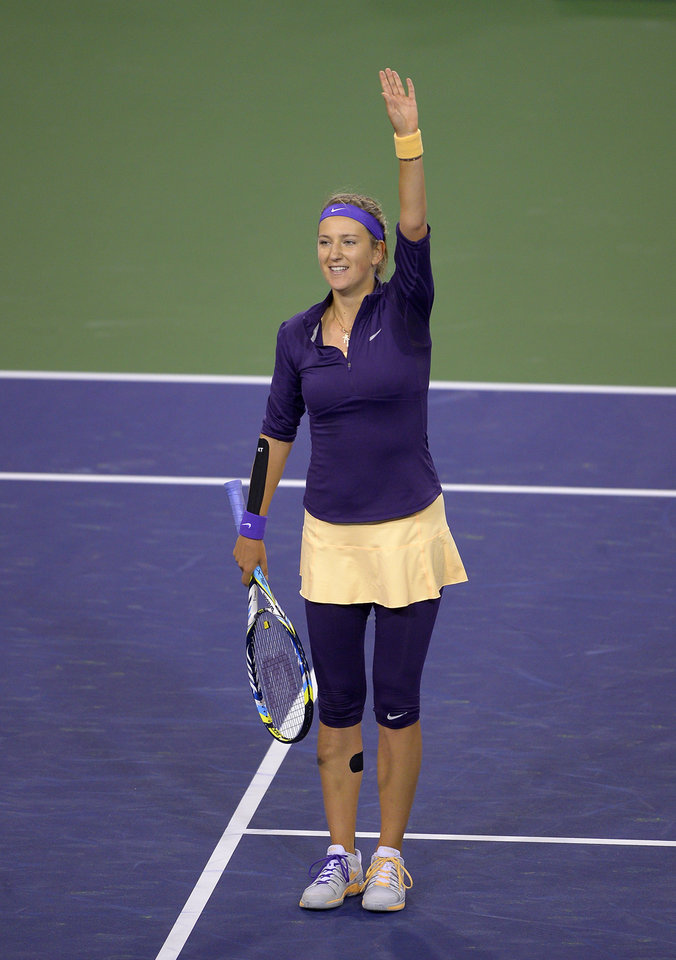 Victoria Azarenka, of Belarus, waves to fans after defeating Daniela Hantuchova, of Slovakia, at the BNP Paribas Open tennis tournament, Saturday, March 9, 2013, in Indian Wells, Calif. Azarenka won 6-4, 6-1. (AP Photo/Mark J. Terrill)
