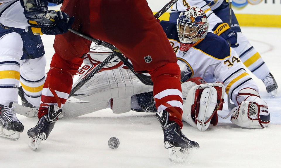 Photo - Buffalo Sabres goalie Michal Neuvirth (34), of the Czech Republic, eyes the puck during the second period of an NHL hockey game against the Carolina Hurricanes in Raleigh, N.C., Thursday, March 13, 2014. (AP Photo/Karl B DeBlaker)