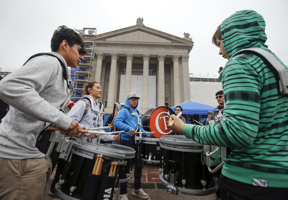 Photo - Drummers from Guymon High School play on the south side of the state Capitol during the fifth day of a walkout by Oklahoma teachers, in Oklahoma City, Friday, April 6, 2018. Photo by Nate Billings, The Oklahoman