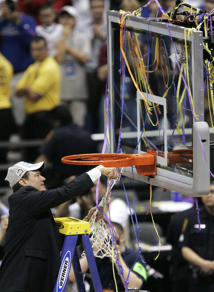 Photo - NCAA TOURNAMENT, CELEBRATE, CELEBRATION, NET: University of Kansas head coach Bill Self cuts down the net following his team's 75-68 overtime win over Memphis in the championship game at the NCAA college basketball Final Four, Monday, April 7, 2008, in San Antonio. (AP Photo/Matt York) ORG XMIT: FF176