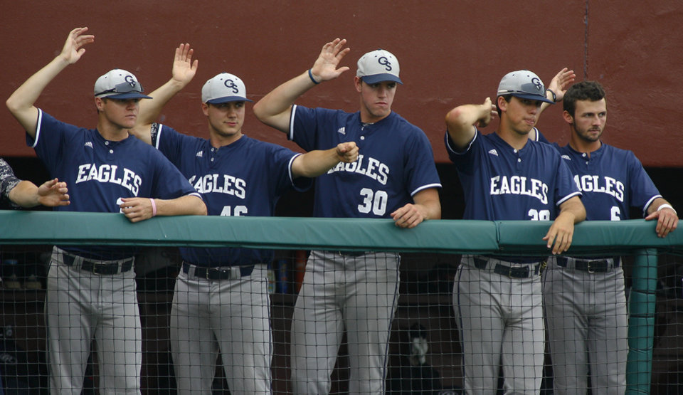 Photo - Georgia Southern players try to distract Florida State players on the field in the fourth inning of an NCAA college baseball tournament regionalgame Friday, May 30, 2014 in Tallahassee, Fla. Georgia Southern defeated Florida State 7-0. (AP Photo/Phil Sears)