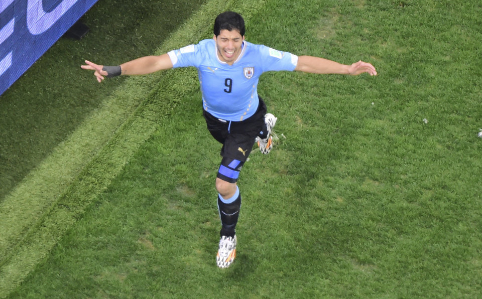 Photo - Uruguay's Luis Suarez celebrates scoring his side's second goal during the group D World Cup soccer match between Uruguay and England at the Itaquerao Stadium in Sao Paulo, Brazil, Thursday, June 19, 2014.  (AP Photo/Francois Xavier Marit, pool)