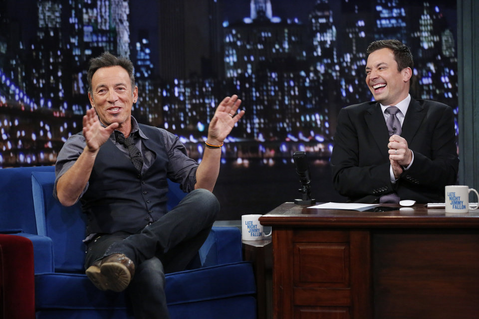 Photo - This image released by NBC shows Bruce Springsteen, left, with host Jimmy Fallon  during an appearance on