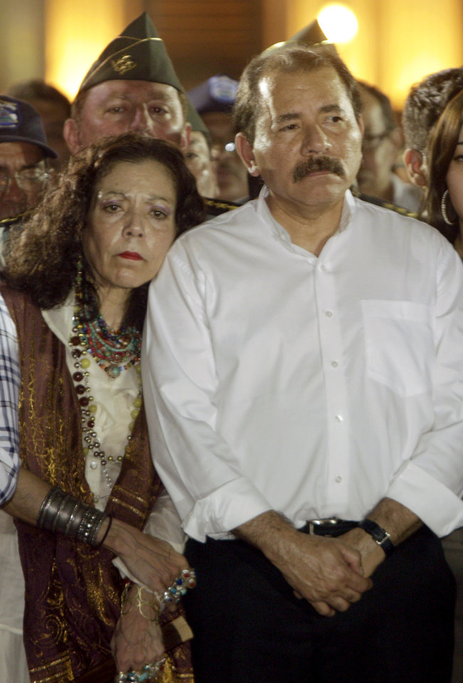 Photo -   FILE - In this May 2, 2012 file photo, Nicaragua's President Daniel Ortega and first lady Rosario Murillo attend the funeral of the late Tomas Borge, in Managua, Nicaragua. Borge, the country's powerful interior minister from 1979 to 1990 and Sandinista hard-liner died on April 30 at age 81 after being hospitalized for pneumonia and other ailments. In death, Borge has been given near-saint status by Ortega and his wife. Critics suggest they are using the mourning to bolster the legitimacy of a government whose last election was widely questioned. (AP Photo/Arnulfo Franco, File)