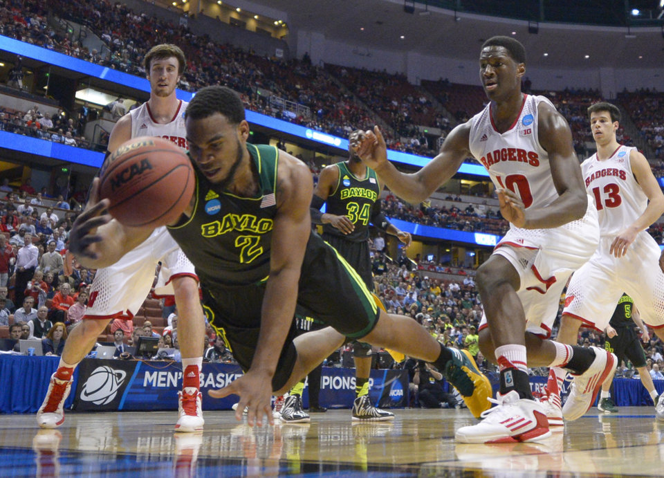 Photo - Baylor forward Rico Gathers (2) dives for a loose ball during the first half against Wisconsin in an NCAA men's college basketball tournament regional semifinal, Thursday, March 27, 2014, in Anaheim, Calif. (AP Photo/Mark J. Terrill)