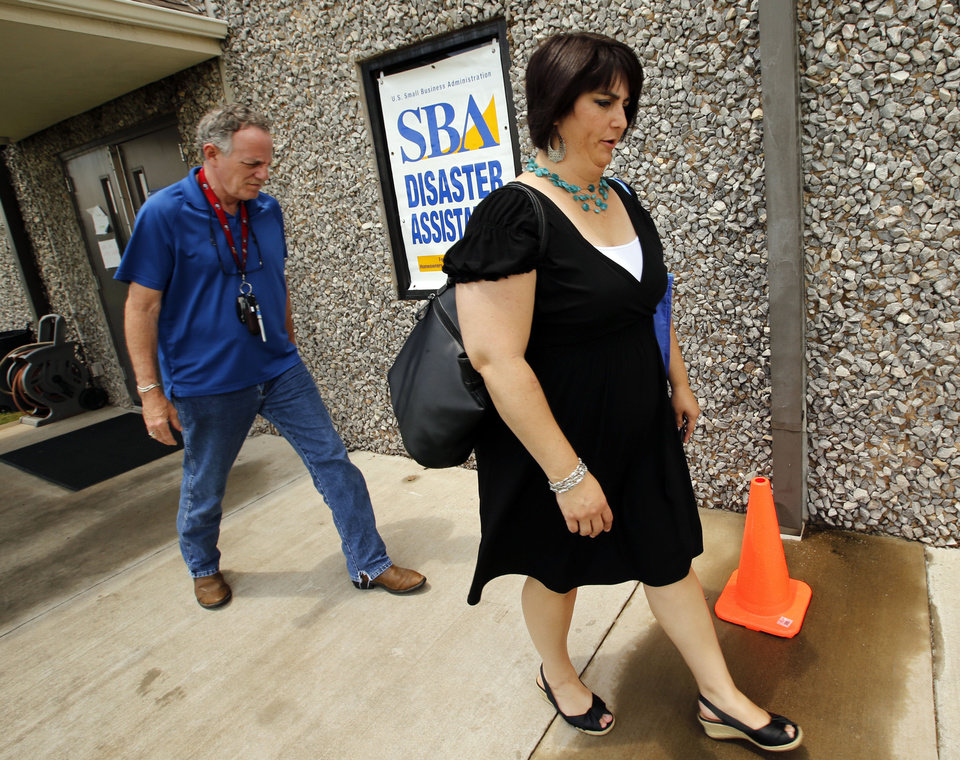 Heather Thompson,right, and FEMA IT specialist Kirk Thomas walk out of the disaster recovery center at Capitol Hill Baptist Church on Wednesday, July 17, 2013, in Oklahoma City, Okla.  Photo by Steve Sisney, The Oklahoman
