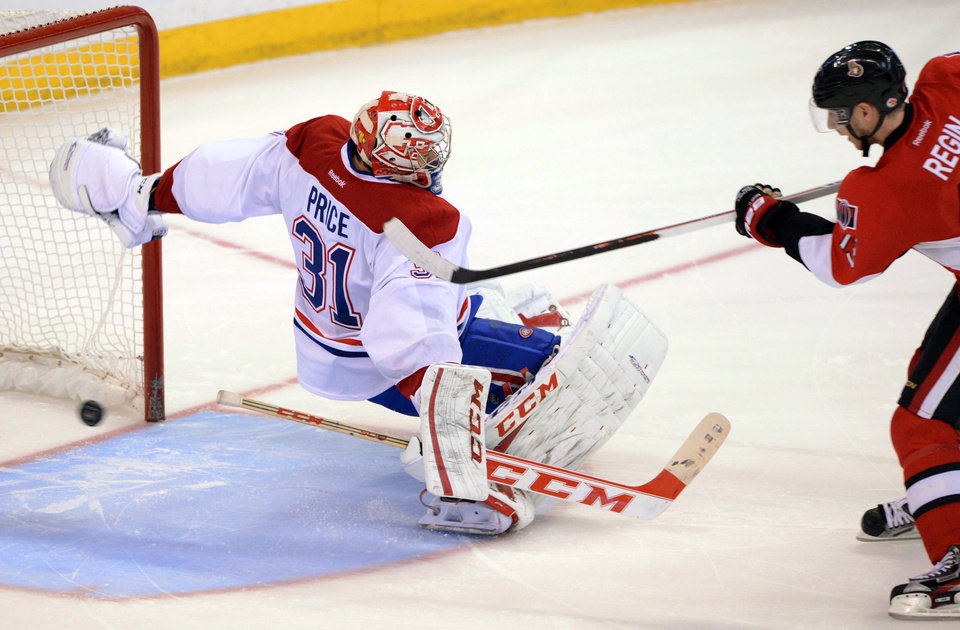 Photo - Ottawa Senators' Peter Regin, right, puts his winning shootout attempt past Montreal Canadiens goaltender Carey Price during their NHL hockey game, Monday, Feb. 25, 2013, in Ottawa, Ontario. The Senators won 2-1. (AP Photo/The Canadian Press, Sean Kilpatrick)