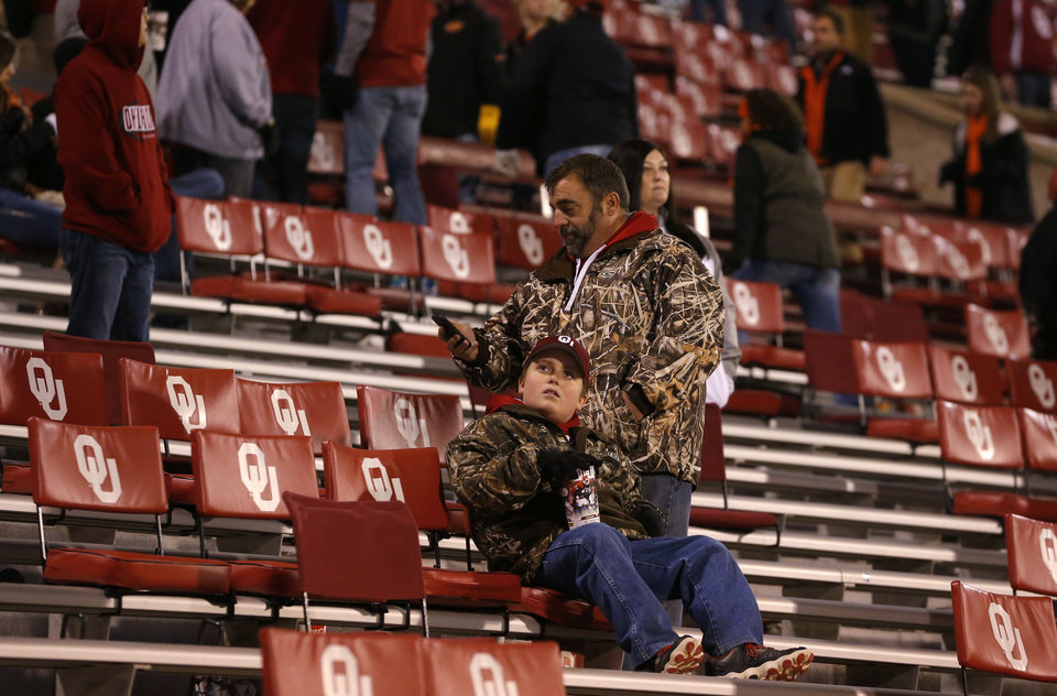 Photo - Oklahoma fans watch after a Bedlam college football game between the University of Oklahoma Sooners (OU) and the Oklahoma State Cowboys (OSU) at Gaylord Family-Oklahoma Memorial Stadium in Norman, Okla., Saturday, Dec. 6, 2014. Photo by Bryan Terry, The Oklahoman