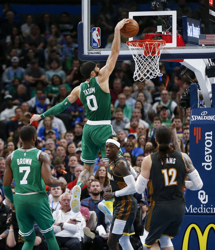 Photo - Boston's Jayson Tatum (0) dunks the ball near Oklahoma City's Dennis Schroder (17) as Steven Adams (12) and Boston's Jaylen Brown (7) look on in the fourth quarter during an NBA basketball game between the Oklahoma City Thunder and the Boston Celtics at Chesapeake Energy Arena in Oklahoma City, Sunday, Feb. 9, 2020. Boston won 112-111. [Nate Billings/The Oklahoman]