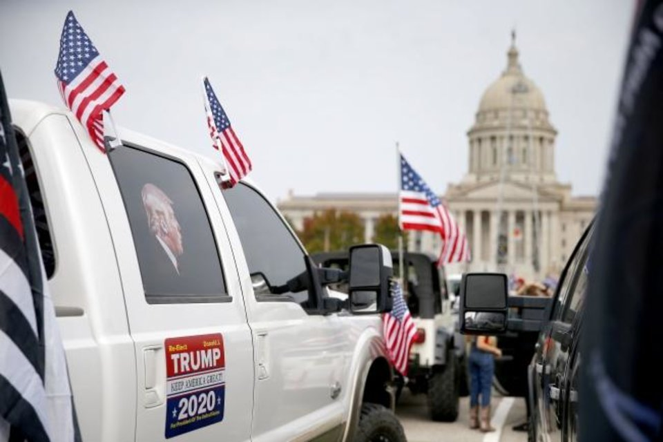 Photo -  A truck decorated to show support for President Donald Trump is seen at the state Capitol Saturday. [Bryan Terry/The Oklahoman]