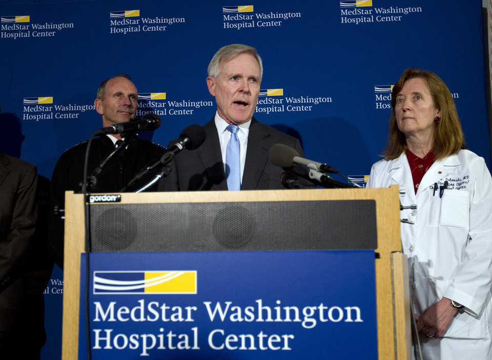Photo - Secretary of the Navy Ray Mabus  speaks during a news conference at Washington Hospital Center, in Washington, Monday, Sept. 16, 2013, after he visited those injured at the shooting at Navy Yard building. With him at right is chief operating officer Dr. Janis M. Orlowski and Adm. Jonathan Greenert. (AP Photo/Jose Luis Magana)