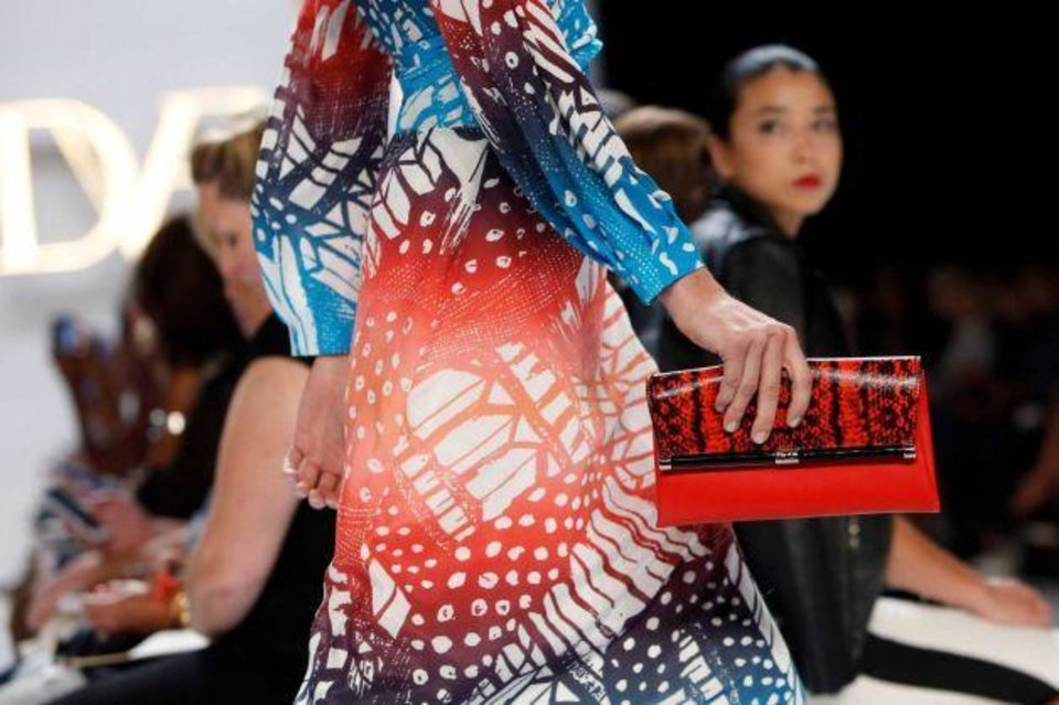 Photo -  One of the outfits from Diane Von Furstenberg's spring 2014 collection shown on the runway in New York. AP PHOTO
