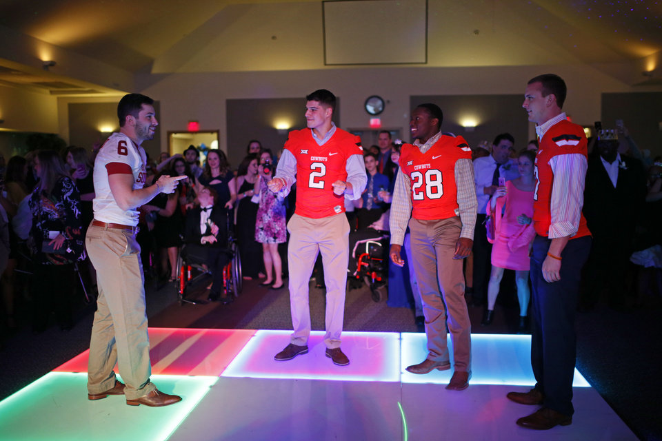 Photo -  Oklahoma quarterback Baker Mayfield (left) and Oklahoma State quarterback Mason Rudolph (second from left) have become friends despite being on opposite sides of Bedlam. This past February, they were part of