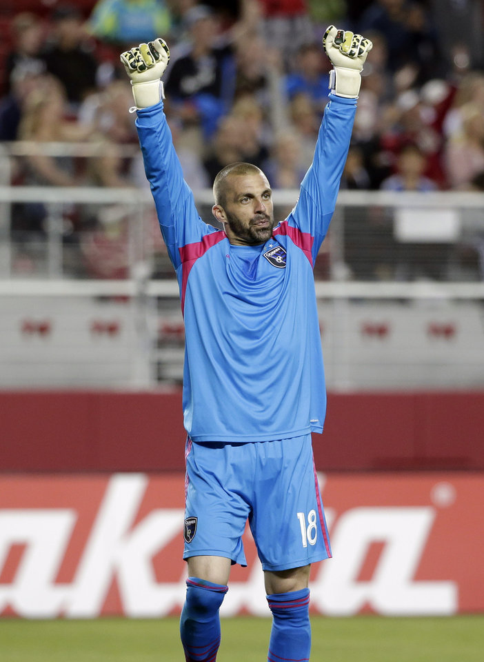 Photo - San Jose Earthquakes goalkeeper Jon Busch celebrates after a 1-0 win over the Seattle Sounders during the second half of an MLS soccer match on Saturday, Aug. 2, 2014, in Santa Clara, Calif. (AP Photo/Marcio Jose Sanchez)