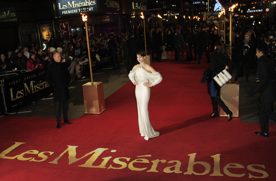 Photo - Anne Hathaway arrives on the red carpet for the World Premiere of 'Les Miserables' at a central London cinema in Leicester Square, Wednesday, Dec. 5, 2012. (Photo by Joel Ryan/Invision/AP)
