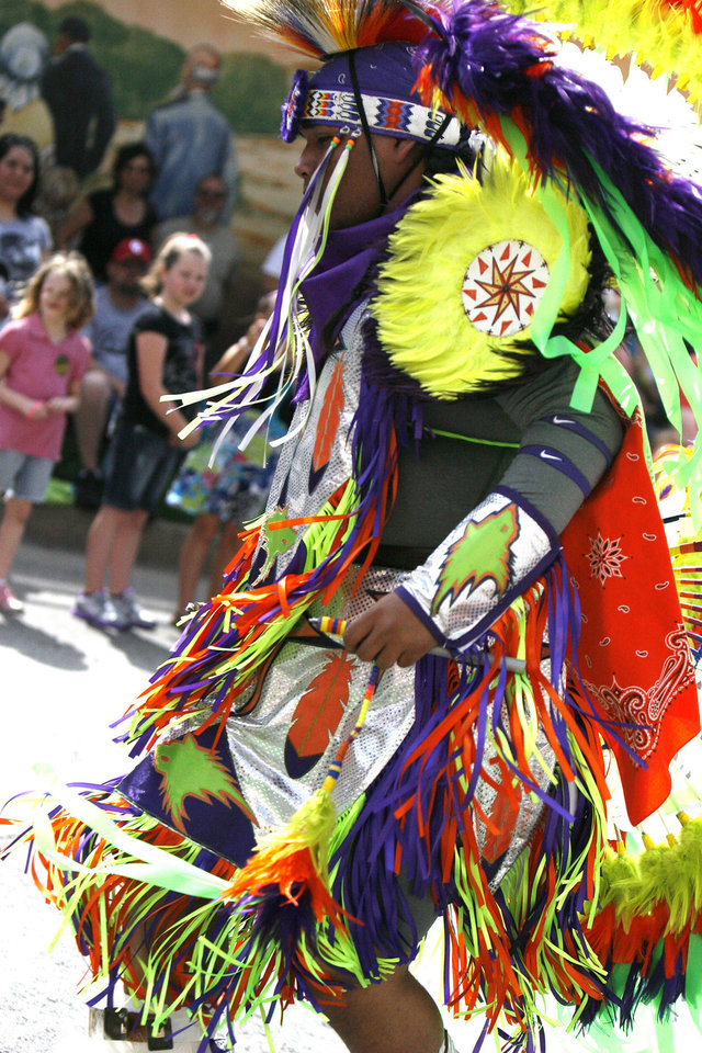 Andrew Whiteshirt, 19, dances during the 2011 Red Earth Festival. Photo by Ashley R. West, The Oklahoman Archives. <strong>Ashley R. West - The OKlahoman</strong>