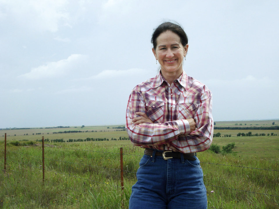 Photo - Terry Stuart Forst smiles while posing in front of the Stuart Ranch on Monument Hill in this 2007 photo. This month she is scheduled to become president of the Oklahoma Cattlemen's Association.  oklahoman ARCHIVE photo
