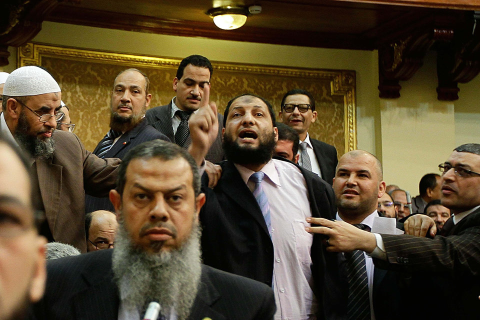 FILE - In this Monday, Feb. 27, 2012 file photo, Egyptian lawmaker Anwar al-Balkimy, center, gestures during a session of parliament in Cairo, Egypt. Egypt's ultraconservative Islamic Al-Nour party said Monday one of its lawmakers has resigned from parliament because he got a nose job and then lied about it, claiming he was beaten. Internal divisions are threatening to unravel Egypt's second biggest political party, the political arm of the ultraconservative Salafis, the country's most hardline Islamist movement. Now its leaders are split over whether Muslim clerics or more pragmatic politicians should be steering the movement. (AP Photo, File)