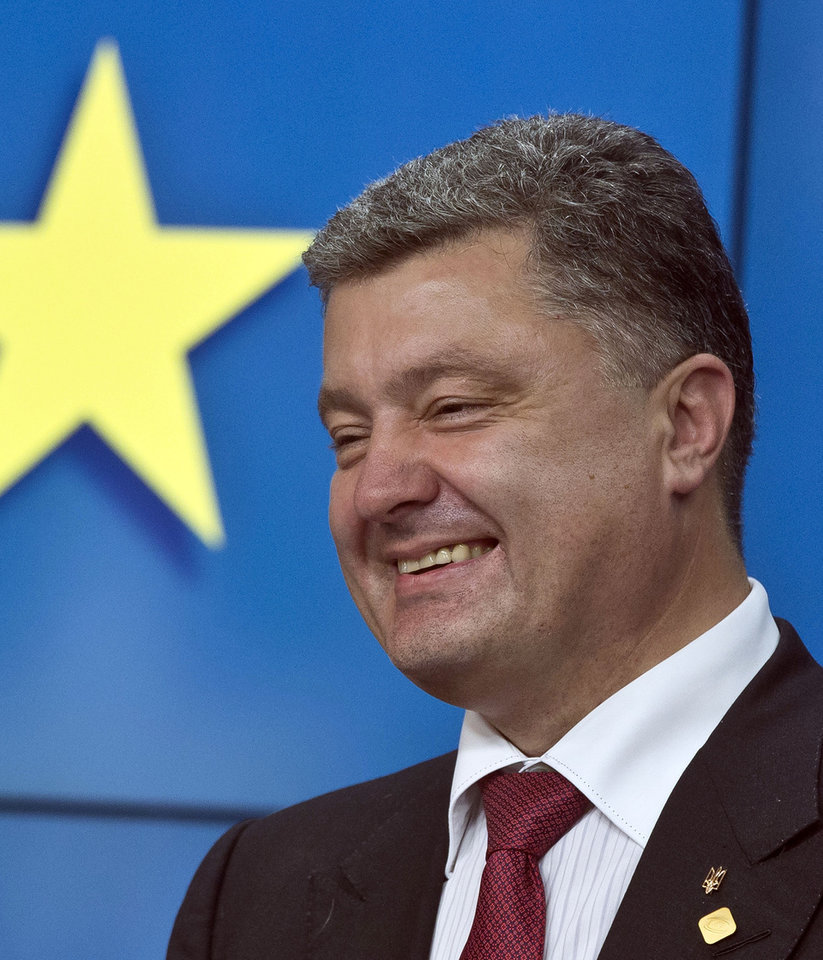 Photo - Ukrainian President Petro Poroshenko speaks during a media conference after a signing ceremony at an EU summit in Brussels on Friday, June 27, 2014. The Ukrainian President Petro Poroshenko has signed up to a trade and economic pact with the European Union, saying it may be the
