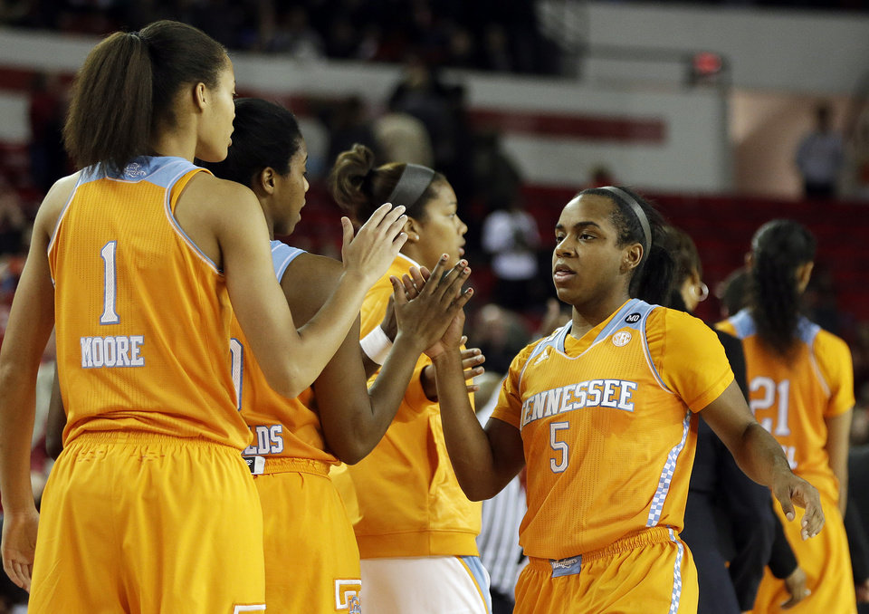 Photo - Tennessee guard Ariel Massengale (5) celebrates with her teammates as she leaves the game in the fianl moments of the second half of an NCAA college basketball game  after the game against Georgia, Sunday, Jan. 5, 2014, in Athens, Ga. Tennessee  won 85-70. (AP Photo/John Bazemore)