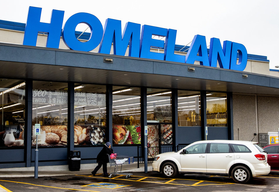 Photo - Exterior of a Homeland grocery store as customers make their way to shop in Oklahoma City, Okla. on Tuesday, March 17, 2020.  [Chris Landsberger/The Oklahoman]