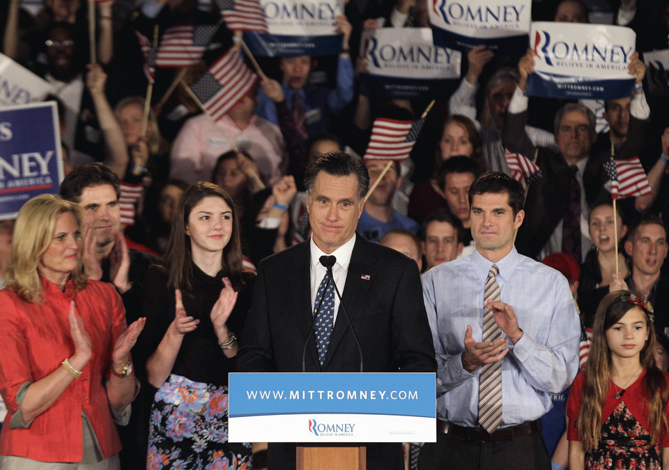 Photo - Republican presidential candidate former Massachusetts Gov. Mitt Romney speaks during the South Carolina Primary night rally as, from left, wife Ann, son Tagg, granddaughter Allie, son Matt, and granddaughter Chloe, look on Saturday, Jan. 21, 2012, in Columbia, S.C. Former House Speaker Newt Gingrich won the Republican primary Saturday night. (AP Photo/David Goldman) ORG XMIT: SCDG119