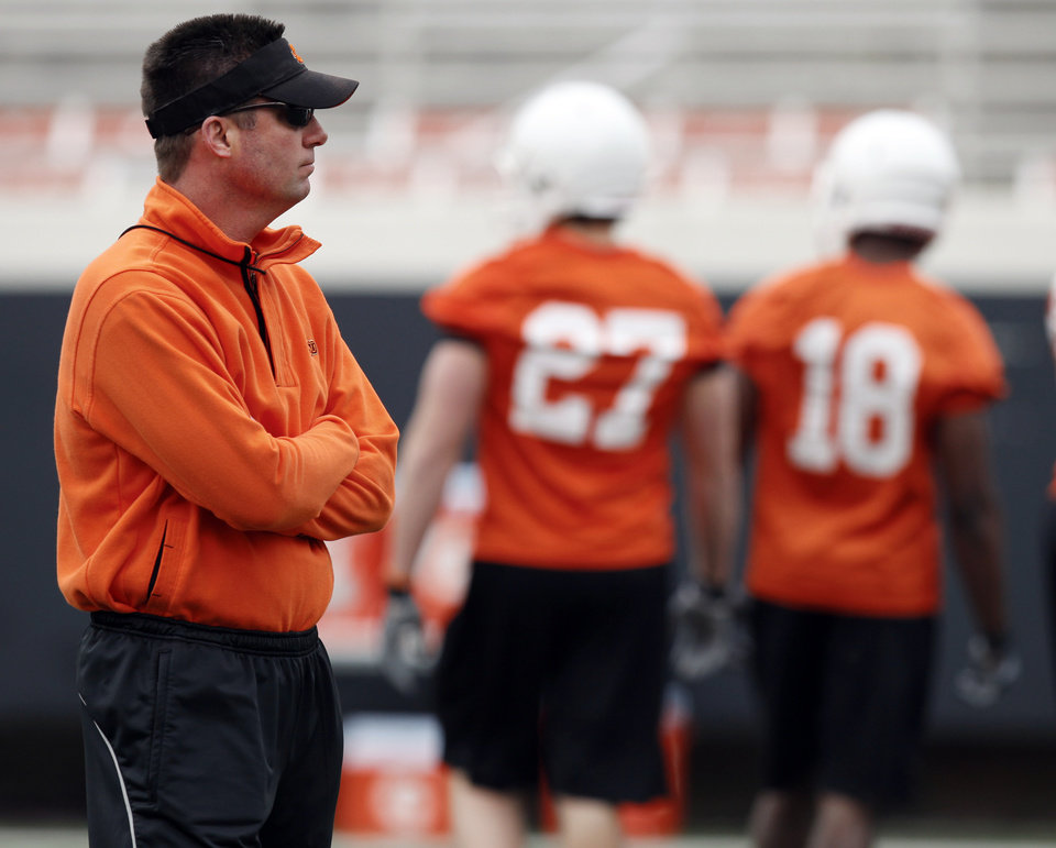 Photo - OSU head coach Mike Gundy watches his team during Oklahoma State spring football practice at Boone Pickens Stadium in Stillwater, Okla., Monday, March 7, 2011. Photo by Nate Billings, The Oklahoman