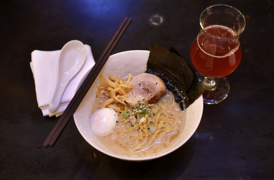 Photo - In this Monday, Dec. 30, 2013 photo, a bowl of ramen noodles sits next to a glass of beer at the Backbar restaurant and bar in Somerville, Mass. Over the past several years, Somerville's eclectic Union Square neighborhood has become a drinking and dining destination. (AP Photo/Steven Senne)