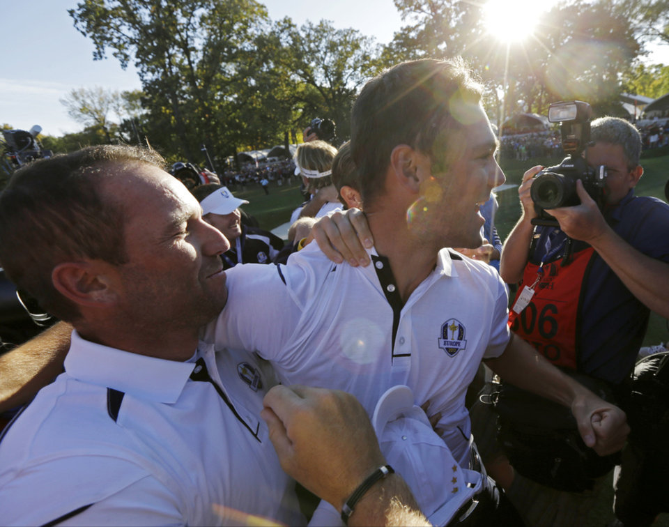 Europe's Martin Kaymer celebrates with Sergio Garcia after winning the Ryder Cup PGA golf tournament Sunday, Sept. 30, 2012, at the Medinah Country Club in Medinah, Ill. (AP Photo/David J. Phillip)  ORG XMIT: PGA197