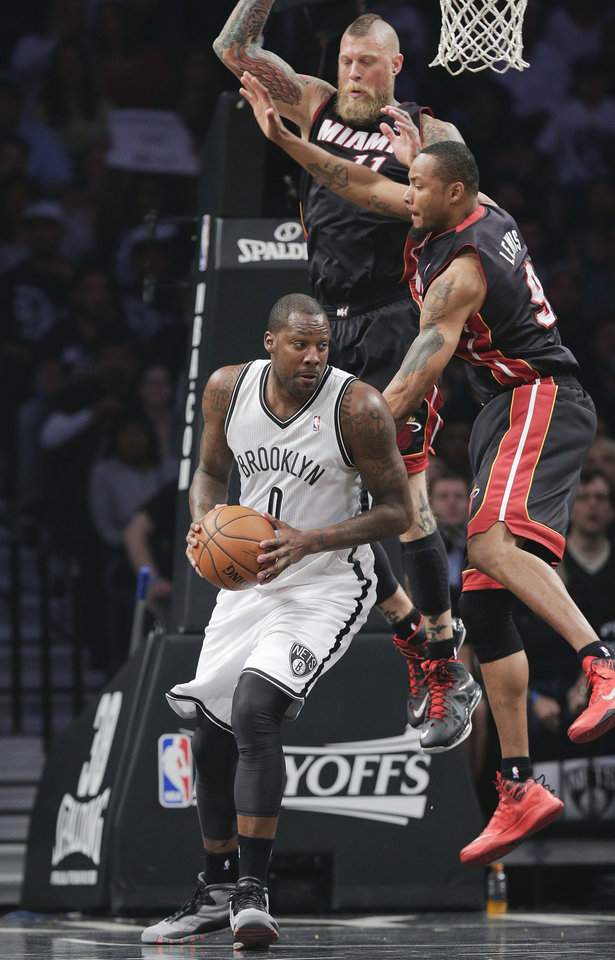 Photo - Miami Heat forward Rashard Lewis (9) and forward Chris Andersen (11) double-team Brooklyn Nets center Andray Blatche (0) in the first period during Game 3 of an Eastern Conference semifinal NBA playoff basketball game on Saturday, May 10, 2014, in New York. (AP Photo/Julie Jacobson)