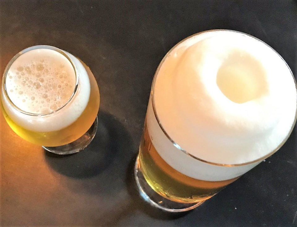 Photo - The top of a long-poured pilsner will appear to have a doughnut resting on it.  [Dave Cathey/The Oklahoman]