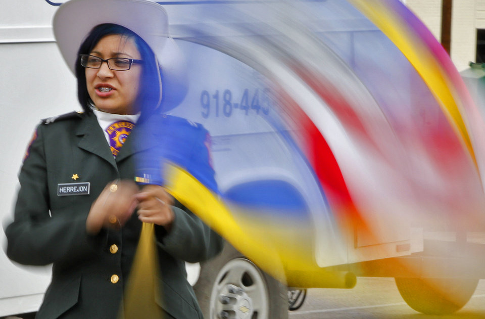 Angela Herrejon of the Northwest Classen ROTC spins a flag what warming up before the start of the Martin Luther King Jr. Day parade through downtown Oklahoma City on Monday, Jan. 16, 2012, in Oklahoma City, Okla. Photo by Chris Landsberger, The Oklahoman