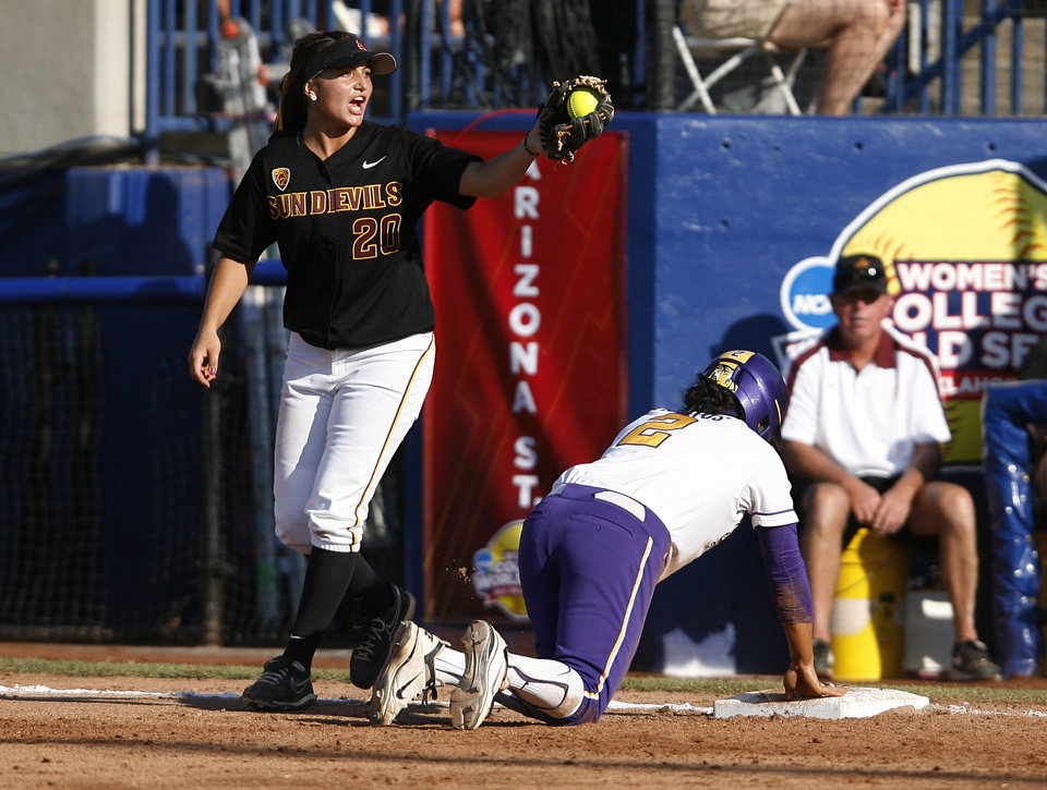 Arizona's Sam Parlich (20) tags LSU's Juliana Santos (2) during a Women's College World Series game between Arizona State and LSU at ASA Hall of Fame Stadium in Oklahoma City, Saturday, June 2, 2012.  Photo by Garett Fisbeck, The Oklahoman
