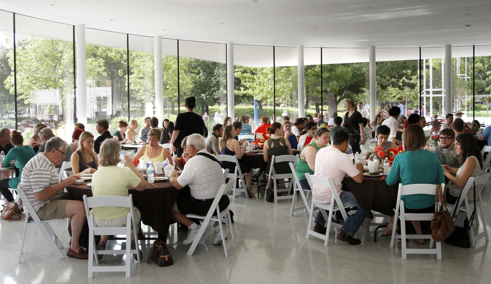 Photo - People gather at the Myriad Gardens to eat at the OK Chefs Relief on the second night of the charity event in Oklahoma City on May 27, 2013. Photo by KT King, The Oklahoman