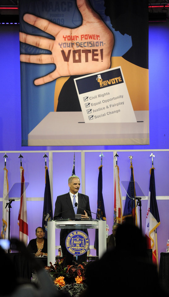 Photo -   U.S. Attorney General Eric Holder speaks at the NAACP annual convention Tuesday, July 10, 2012, in Houston. Holder says he opposes a new photo ID requirement in Texas elections because it would be harmful to minority voters. (AP Photo/Pat Sullivan)