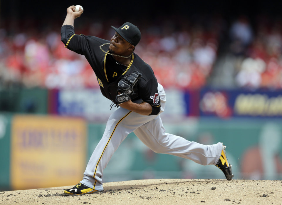 Photo - Pittsburgh Pirates starting pitcher Edinson Volquez throws during the first inning of a baseball game against the St. Louis Cardinals Wednesday, Sept. 3, 2014, in St. Louis. (AP Photo/Jeff Roberson)