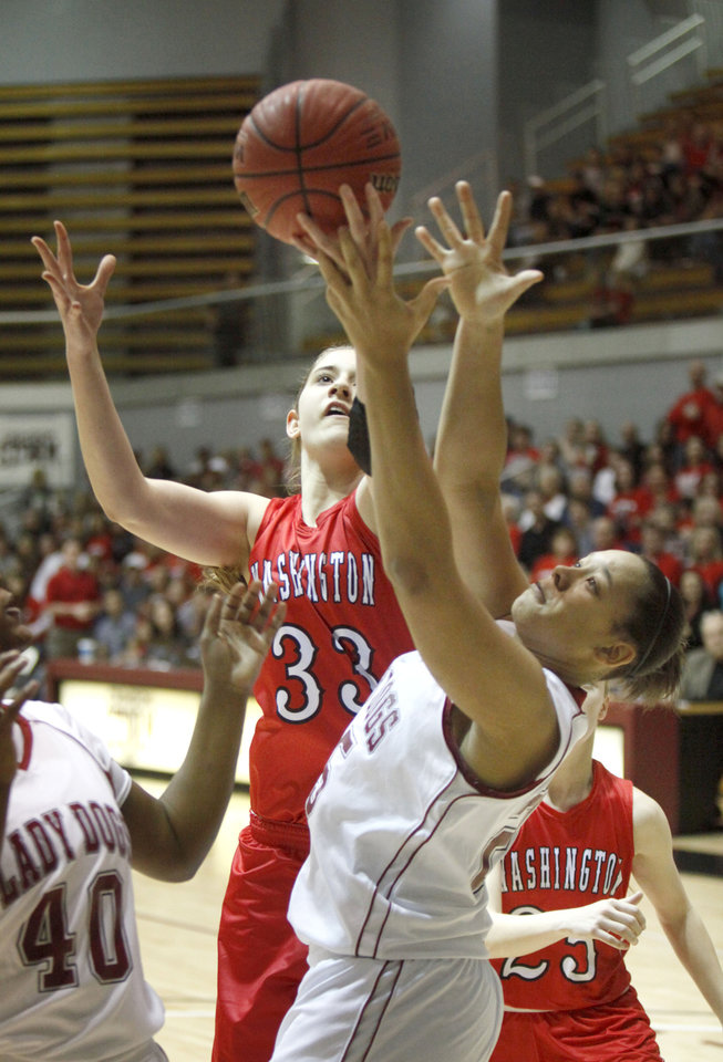 Photo - Washington's Kelsey Johnson and Spiro's Philicea Mack try to get control of a rebound during the Class 3A Girls quarterfinal basketball game at Southern Nazarene University's Sawyer Center in Bethany, OK, Thursday, March 13, 2014,  Photo by Paul Hellstern, The Oklahoman