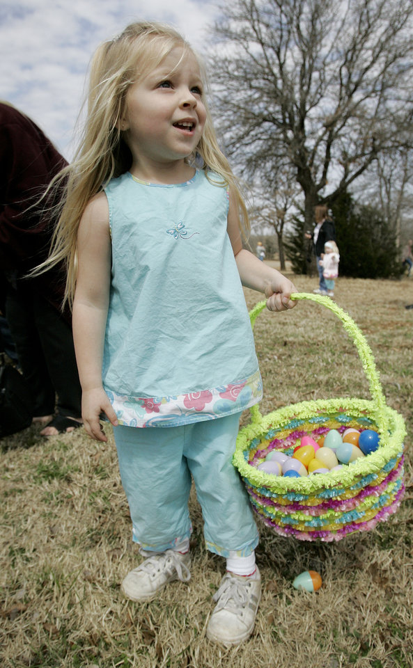 Photo - Ruthie Morrison, 3, of Noble filled her basket at the Easter egg hunt Saturday, March 22, 2008 at Lake Thunderbird. BY JACONNA AGUIRRE/THE OKLAHOMAN