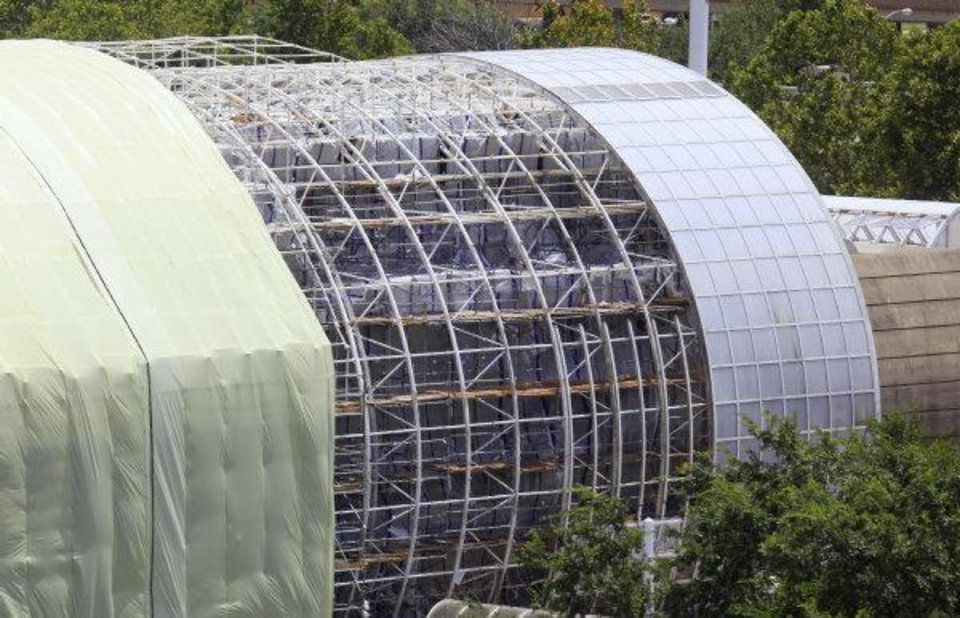 Photo - Construction is ongoing on the Crystal Bridge Tropical Conservatory and the rest of the Myriad Botanical Gardens in downtown Oklahoma City.  PAUL B. SOUTHERLAND - The Oklahoman