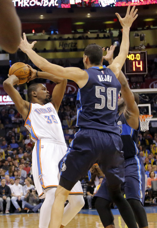 Photo - Dallas' Salah Mejri (50) defends on Oklahoma City's Kevin Durant (35) during the NBA basketball game between the Oklahoma City Thunder and the Dallas Mavericks at Chesapeake Energy Arena on Wednesday, Jan. 13, 2016, in Oklahoma City, Okla.  Photo by Chris Landsberger, The Oklahoman