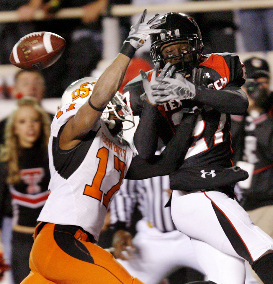 Photo - Oklahoma State's Jacob Lacey (17) breaks up a pass for Texas Tech's Edward Britton (27) during the second half of the college football game between the Oklahoma State University Cowboys (OSU) and the Texas Tech Red Raiders at Jones AT&T Stadium on Saturday, Nov. 8, 2008, in Lubbock, Tex.BY CHRIS LANDSBERGER/THE OKLAHOMAN