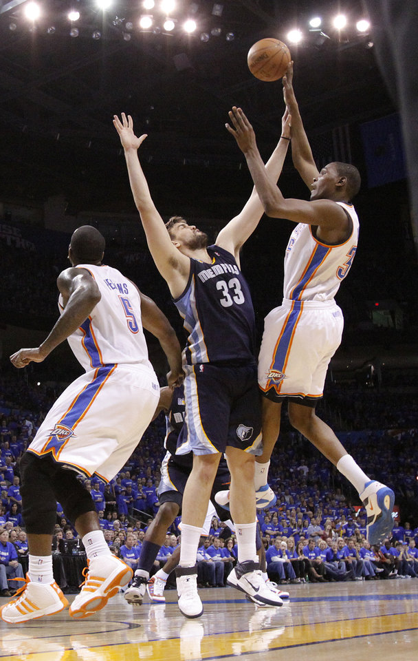 Photo - Oklahoma City's Kevin Durant (35) shoots the ball over Marc Gasol (33) of Memphis during game two of the Western Conference semifinals between the Memphis Grizzlies and the Oklahoma City Thunder in the NBA basketball playoffs at Oklahoma City Arena in Oklahoma City, Tuesday, May 3, 2011. Photo by Chris Landsberger, The Oklahoman