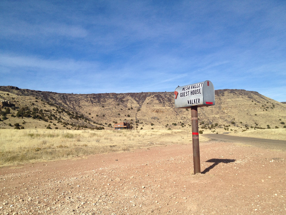 Photo - A single mailbox stands at the base of Black Mesa in the Oklahoma Panhandle in this December 2013 photo. At 4,973 feet, Black Mesa is Oklahoma's highest point. Before becoming a part of Oklahoma Territory, this strip known as No Man's Land was a haven for outlaws and land squatters. Later, during the Great Depression, severe drought and blinding dust storms turned the region into the Dust Bowl. The strong survived, and today the Panhandle of Oklahoma is made up of dedicated ranchers, a growing Hispanic population and awe-inspiring views of rural life at its finest. (AP Photo/Kristi Eaton)