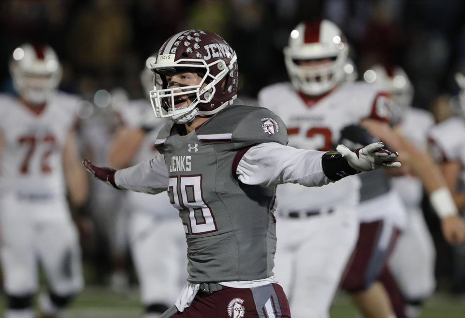 Photo - Jenks Matt Ackerley celebrates after Jenks stops Owasso  during the first quarter of the OSSAA 6A-1 Championship game in Edmond, Okla., Saturday, Dec. 7, 2019. (Alonzo Adams for The Oklahoman)